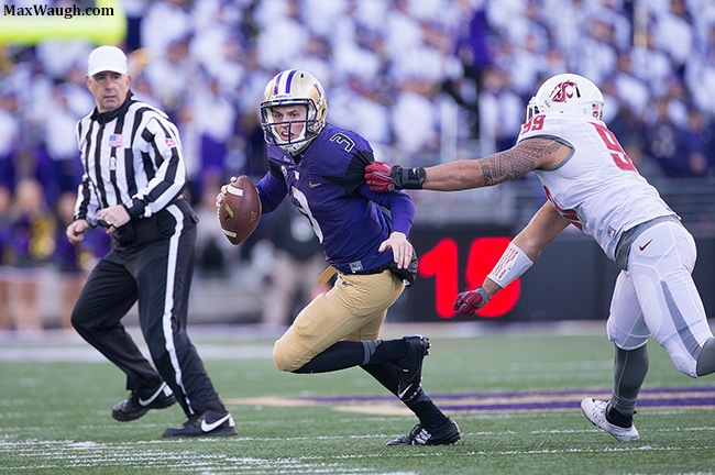 Jake Browning tries to avoid Darryl Paulo.