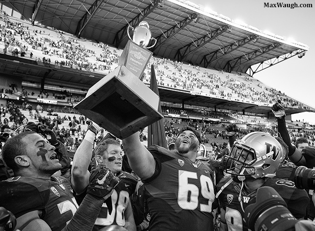 Cory Fuavai hoists the Apple Cup trophy.